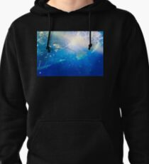 Under the water, a stingray. Pullover Hoodie