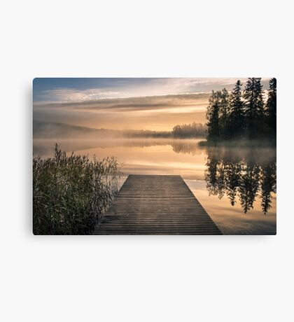 Morning light at the lake with pier Canvas Print