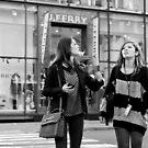 Shoppers' contemplation - Tokyo, Japan by Norman Repacholi