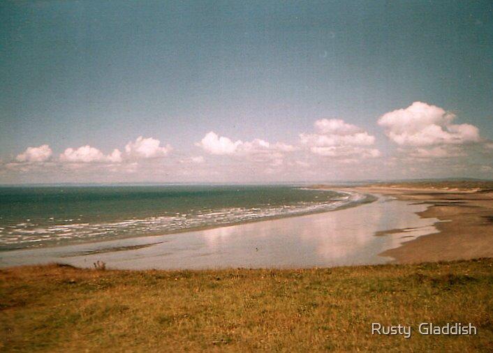 Reflections on Rhossilli Bay by Rusty  Gladdish