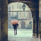 Man with umbrella on a snowy day by Silvia Ganora