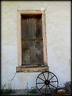 Wagon Wheel by window by Kimberly Chadwick