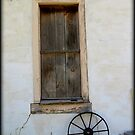 Wagon Wheel by window by Kimberly Chadwick