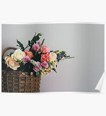Flowers in a rush basket Poster