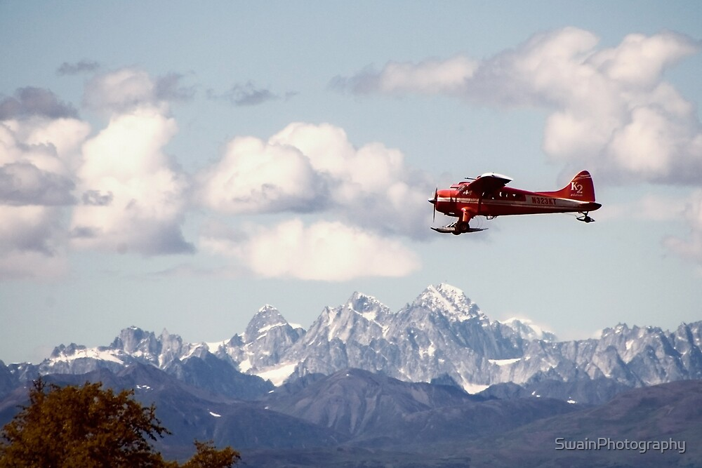 Dehaviland Beaver Flying over the Alaska Range by SwainPhotography