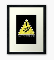CAUTION - Arrows in the knee Framed Print