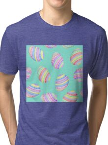 Fun Easter egg design in yellow, red, green, blue, pink and purple stripes on a mint green background Tri-blend T-Shirt
