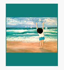 Small Boy Catching Bubbles on a Beach Photographic Print