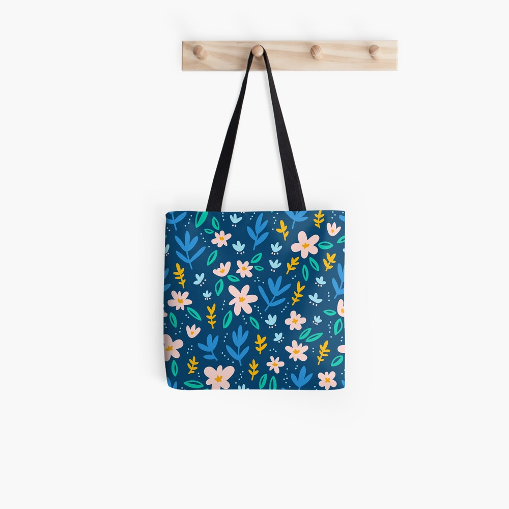 Colorful flowers on deep blue background  Tote Bag