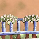 hanging blooms on a railing.  by candace lauer