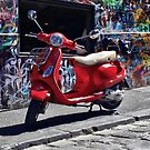 The red Vespa by Steven  Agius