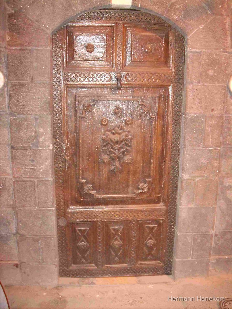 Carved wooden door in the Souk, Damascus, Syria by Hermann Hanekom