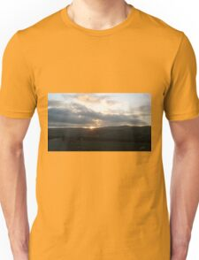 Man walking down country road Unisex T-Shirt