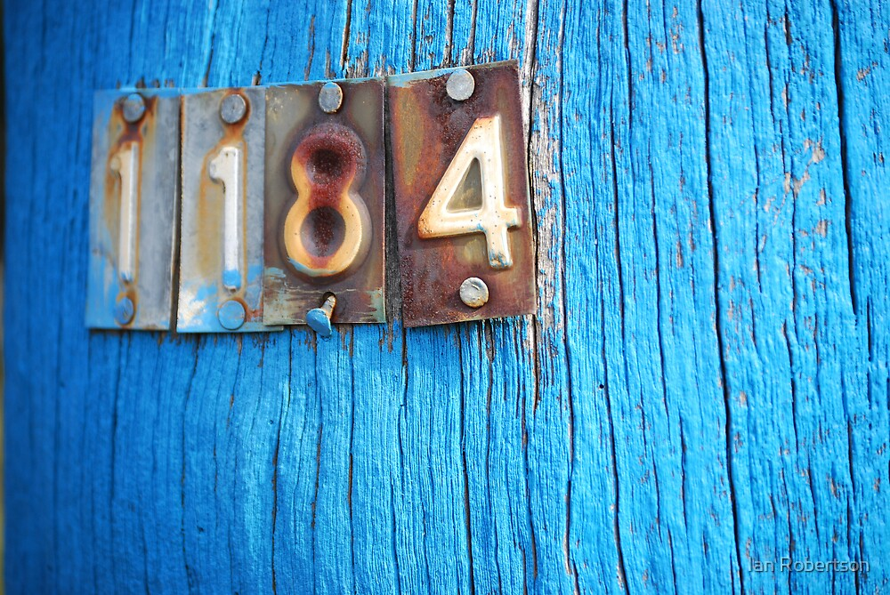 blue pole with numbers by Ian Robertson