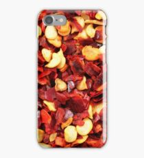 An extremely close up image of crushed red chilis iPhone Case/Skin