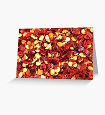 An extremely close up image of crushed red chilis Greeting Card