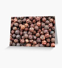 A close up image of whole black peppercorns Greeting Card