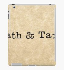"A close up image of the word ""death & taxes"" from a typewriter on antique paper iPad Case/Skin"