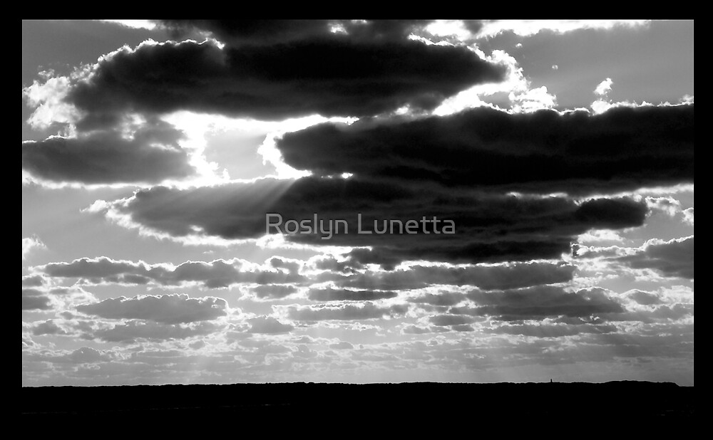 Sunset Rays over Aquinna by Roslyn Lunetta