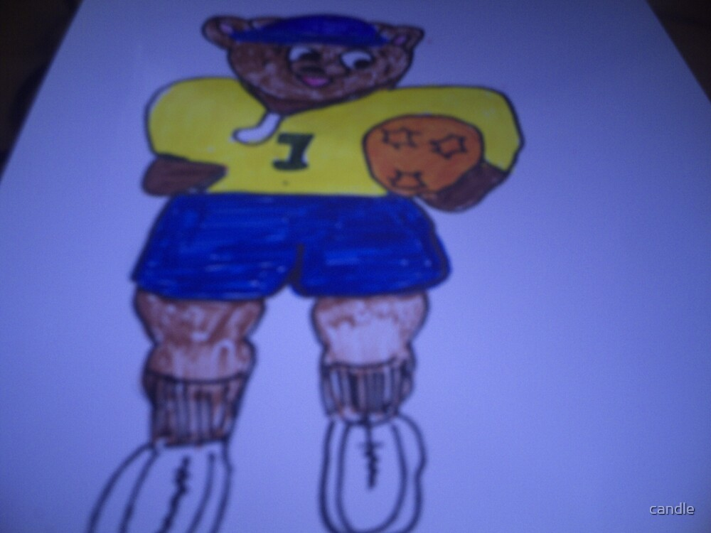 Soccer bear by candle