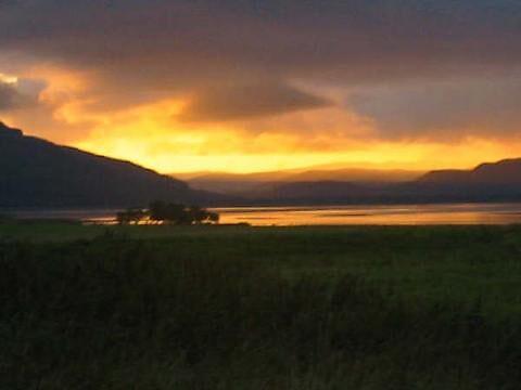 sunset over loch fleet by Nazim