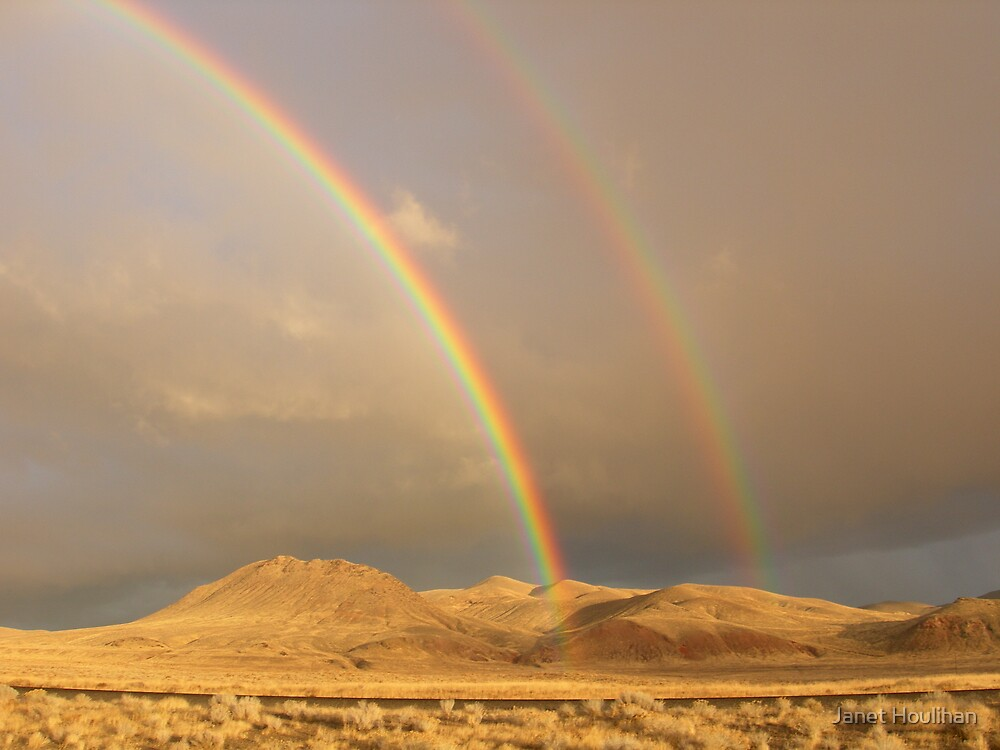 Rainbows over Nevada desert by Janet Houlihan