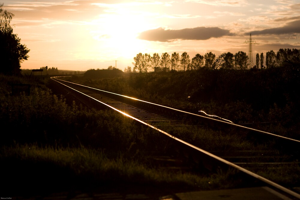 Train track sunsets by Marcus Crafter