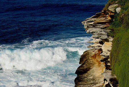 Bondi Beach sea and cliffs by mklau