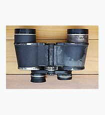 Old military binoculars on table Photographic Print