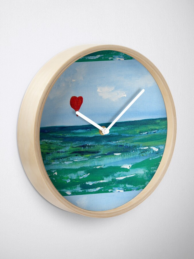 Alternate view of Hot air balloon over the sea Clock