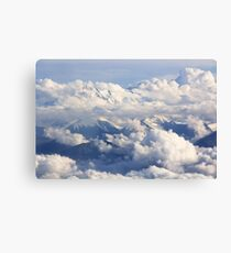Mountains and clouds - aerial view Canvas Print