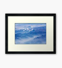 Mountains and clouds - aerial view Framed Print