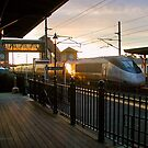 Acela heads into the sunset at Kingston Rhode Island by Jack McCabe