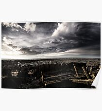 Storm clouds over ship wreck on the beach Poster