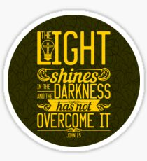 The light shines in the darkness, and the darkness has not overcomeit. Sticker