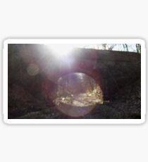 Sun shining on abandoned bridge Sticker