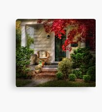 A chair and some flowers Canvas Print