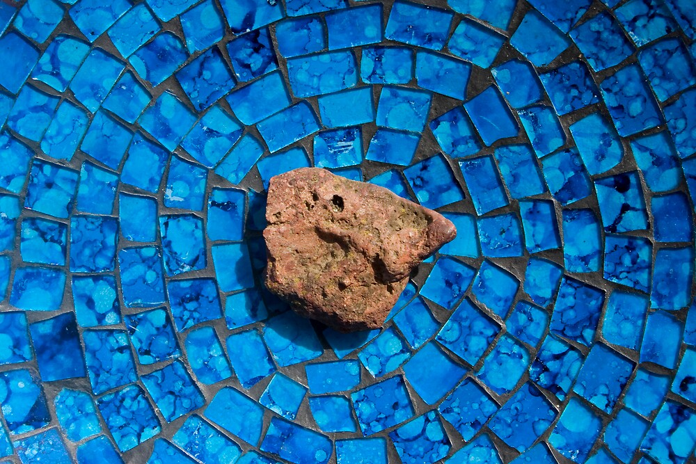 red rock on blue tiles by Michael Chambers