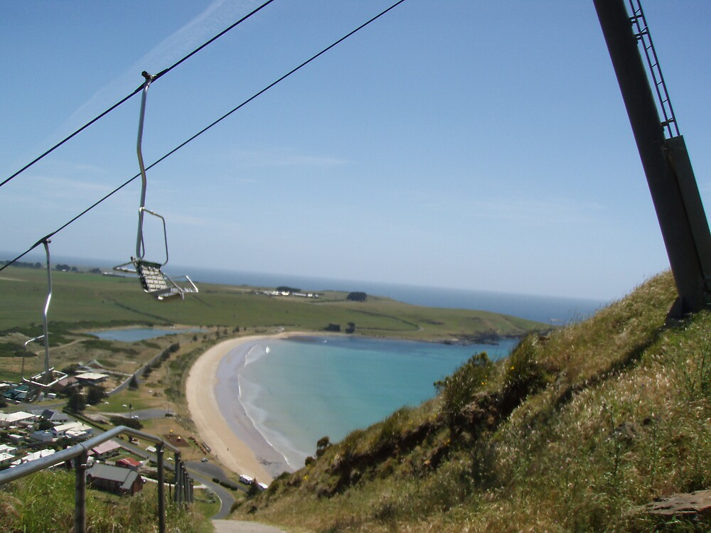 staggering up the steep slope of the Nut, at Stanley, looking down at the gorgeous beach by gaylene