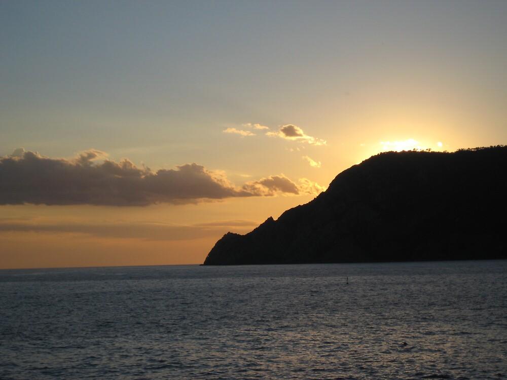 sunset over hill by scott wigley