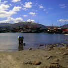 One Sunny Day At Subic Bay Local Fishing Port by Carlo Cesar Rodillas