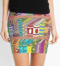 Colorful books on shelves Mini Skirt