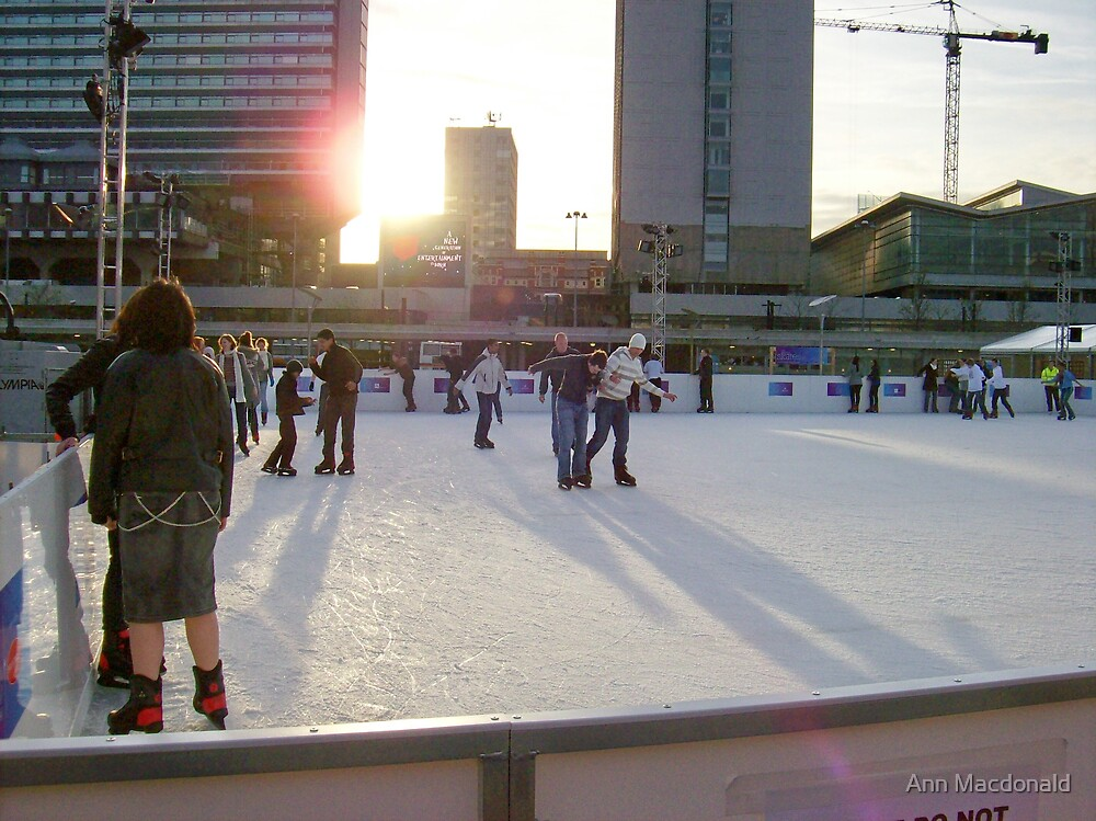 Ice skaters at sunset manchester by Ann Macdonald