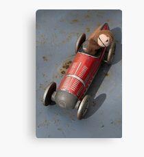 Toy monkey in toy car Canvas Print