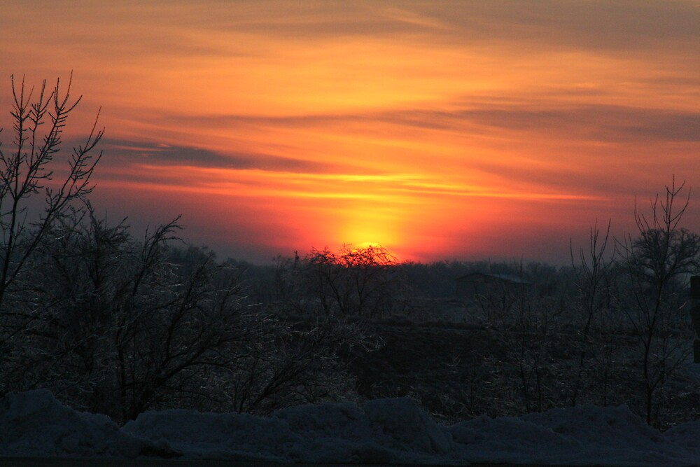December sunset by Rick  McFarland