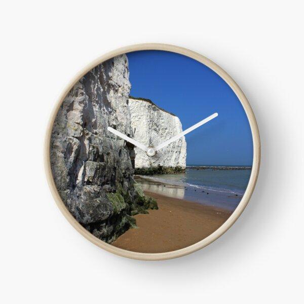 Chalk cliffs and blue flag beach at Kingsgate Clock