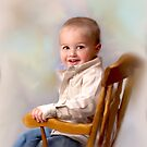 rocking chair young man by Annette