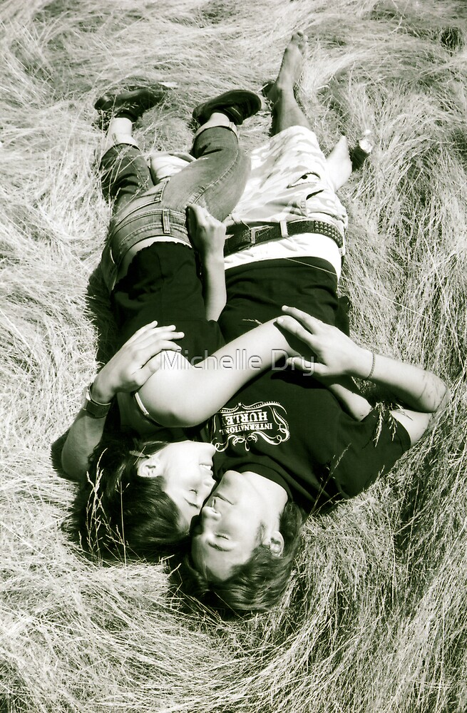 Couple sleeping in grass by Michelle Dry