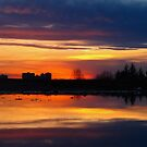 Sandwiched sunset by MarianBendeth