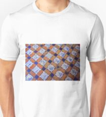 Colorful old mosaic on the floor with blue and orange tiles Unisex T-Shirt